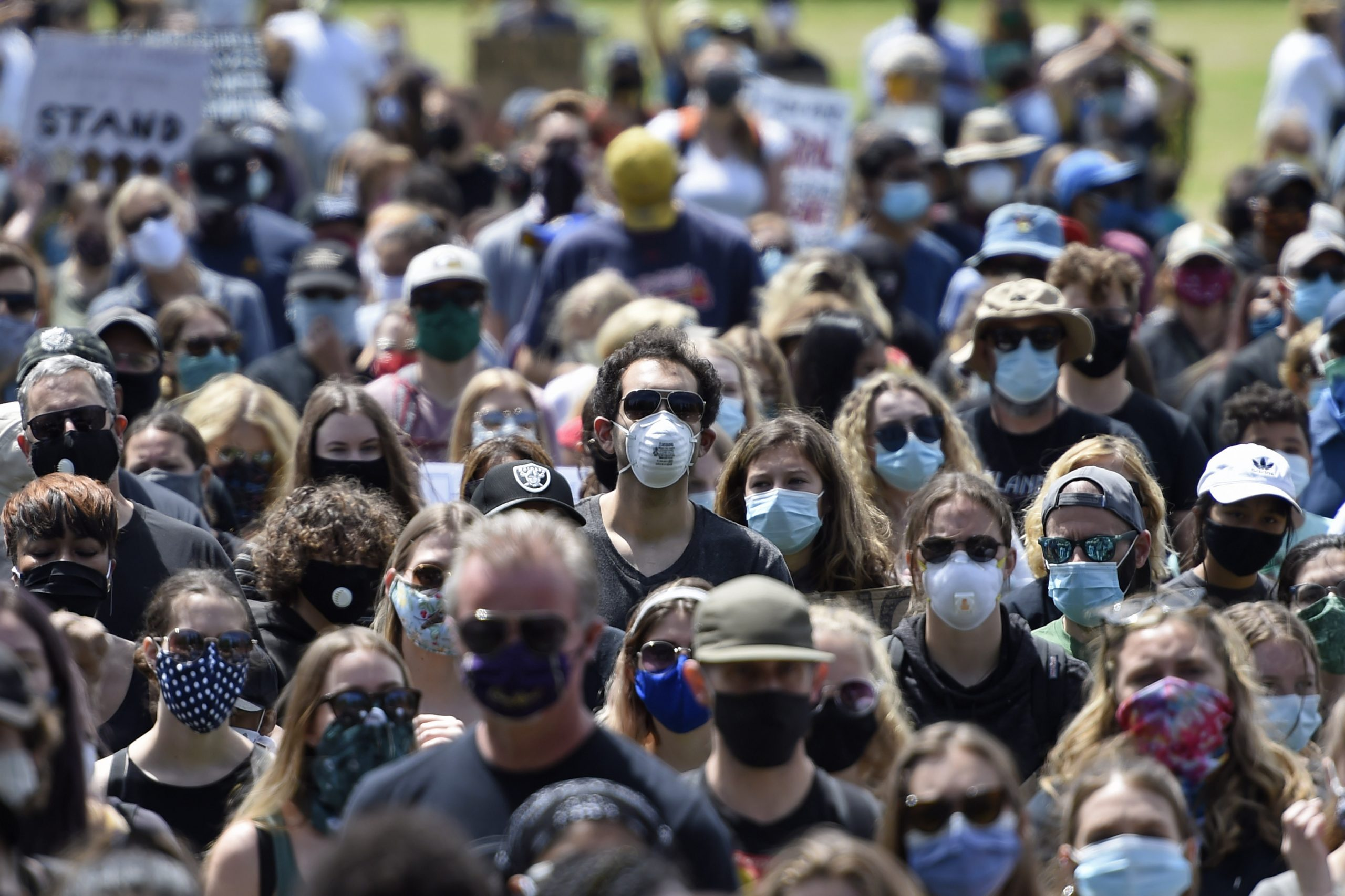 Americans using face masks during rally in the US