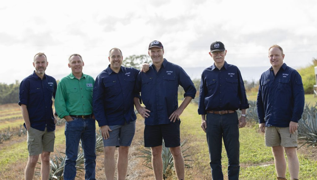 The management and distillers of the Top Shelf International Agave farm