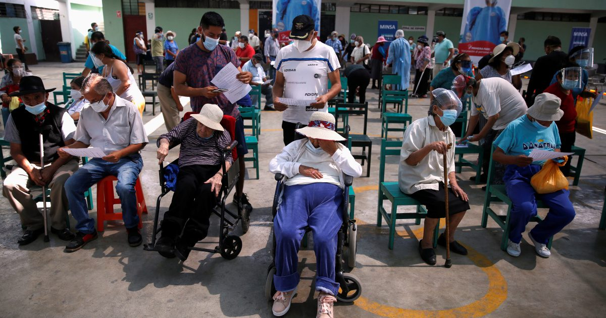 Senior citizens wait to receive a dose of the Pfizer-BioNTech COVID-19 vaccine in Lima, Peru, on March 23 [Sebastian Castaneda/Reuters]
