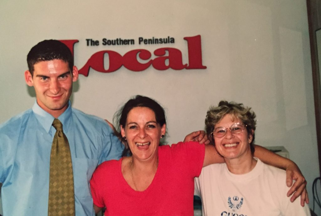 Ahron as a newspaper journalist at The Local, aged 18. With his mother, Carmen, and Zoe Sterling (right)