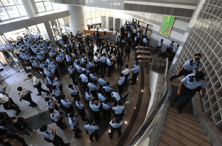 Hong Kong police storm the Apple Daily headquarters.
